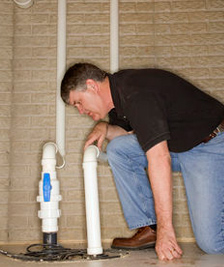 Plumbing contractor in San Jose inspects a PVC connection