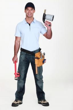 San Jose CA plumbing contractor poses with equipment